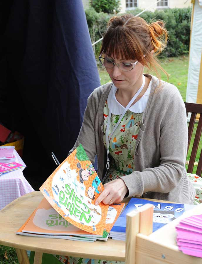 An author signs her latest book at the literary festival youth zone.