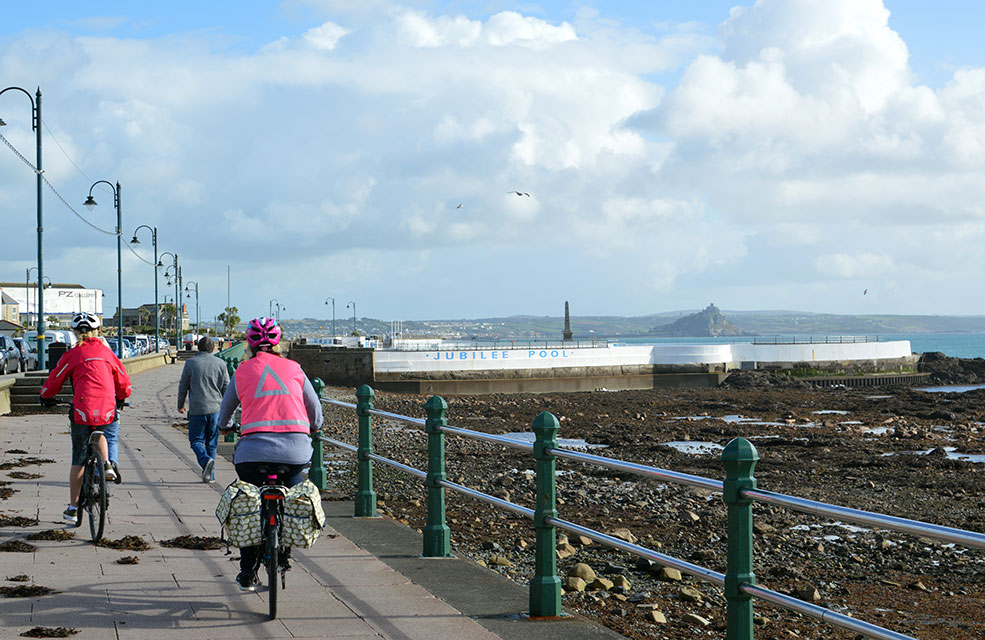 Cycle along the promenade at Penzance before taking a dip in Jubilee Pool.