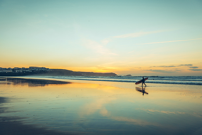 Surfing at Fistral Beach is a fun way to get in the water and get your body moving.