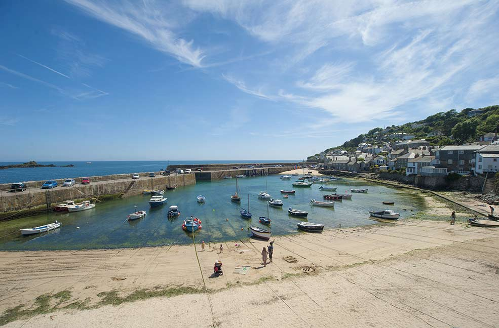 Mousehole harbour by Adam Gibbard