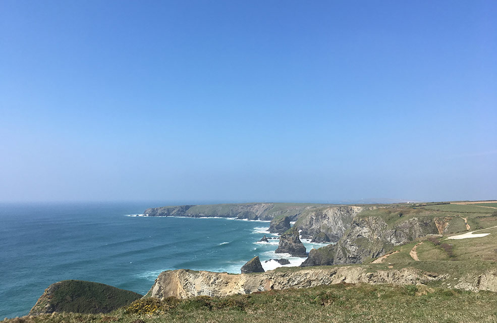 We see Bedruthan Steps in the distance from the coast path and know that we're almost halfway along our walk.