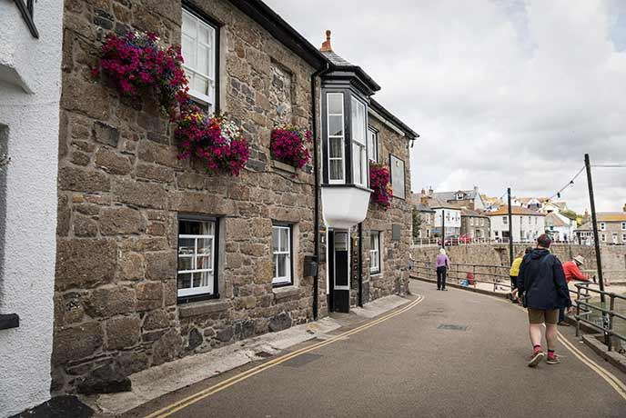 Taking a walk for a pint at the Ship Inn in Mousehole.