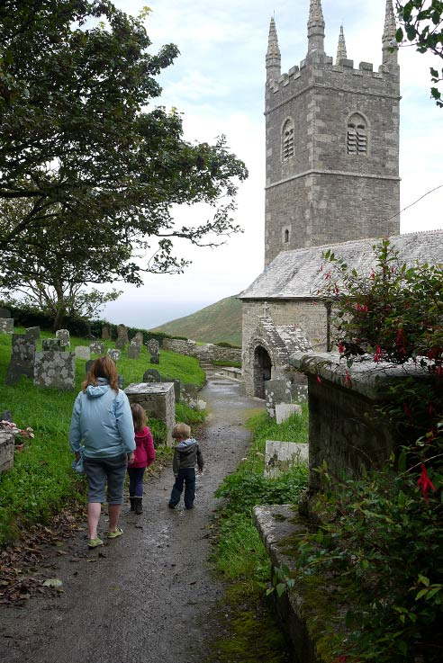 Ali and family look for the graves of the wreck victims buried by Rev Hawker in Church in Morwenstow