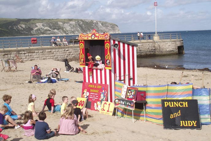 Watch some classic Punch and Judy on the front at Lyme Regis.
