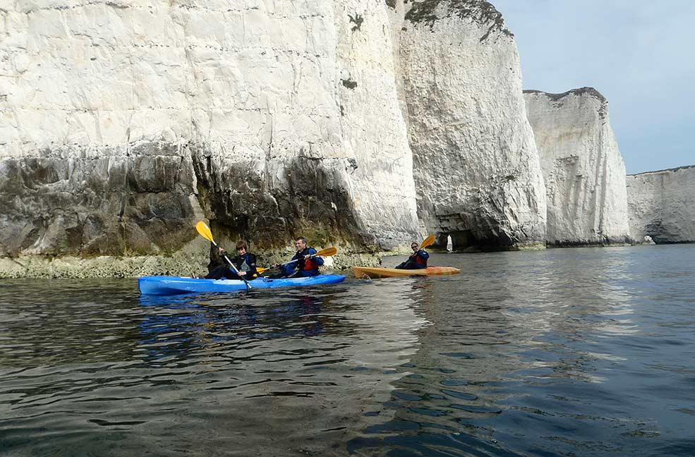 Paddling the coast in a kayak