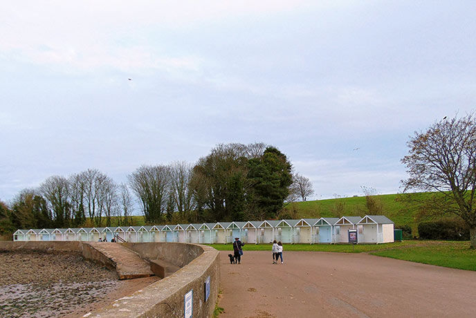 The pretty beach huts of Broadsands bay are a colourful addition to the winter months.