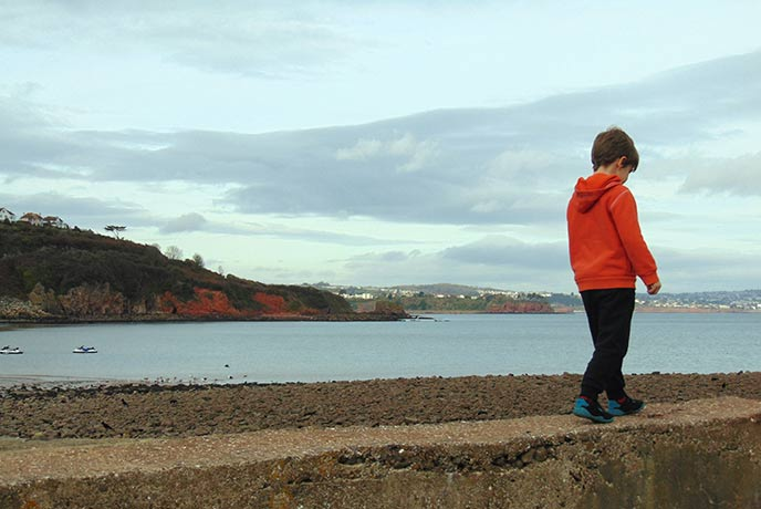 Bring kids along for a walk by the sea.