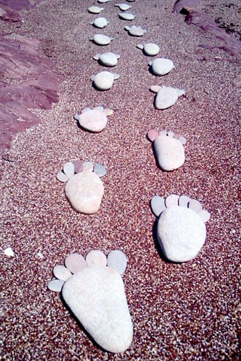 Pebble footstep beach art