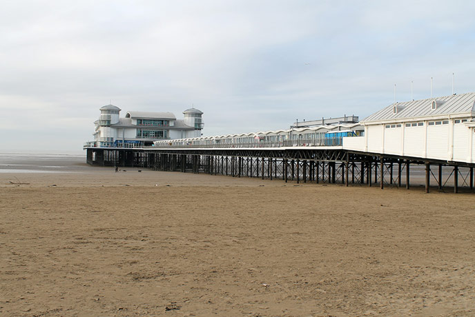 The Grand Pier looms over the beach, home to plenty of amusements and arcades.