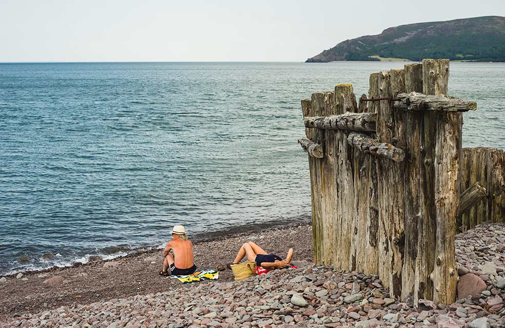 There always seems to be an abundance of sunbathers on the stones at Porlock Weir.