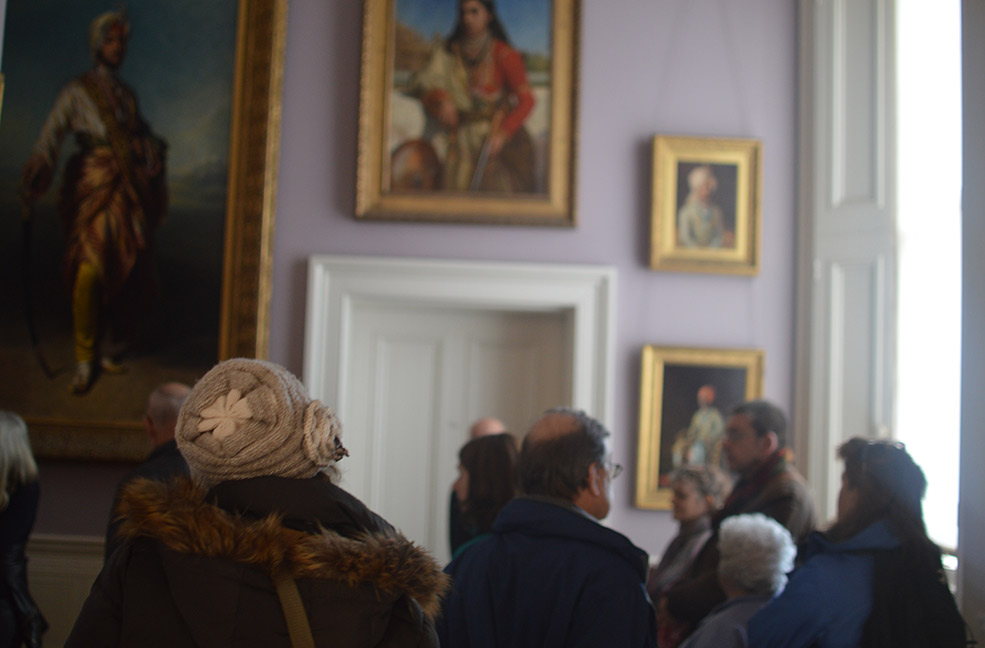 A group touring the hallways of Osborne House on the Isle of Wight