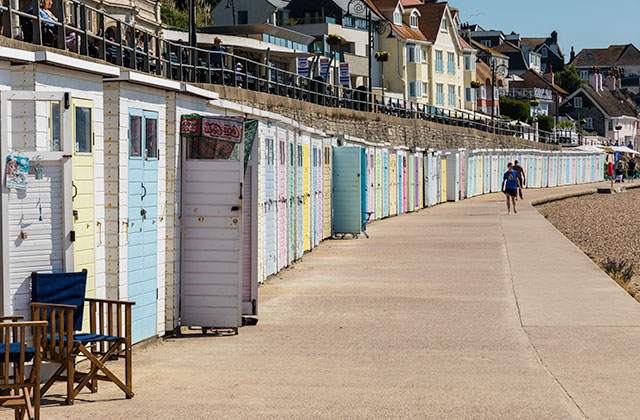 Beach huts along Lyme Regis beach.